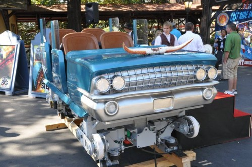 The cars are themed to 1961 Cadillacs.
